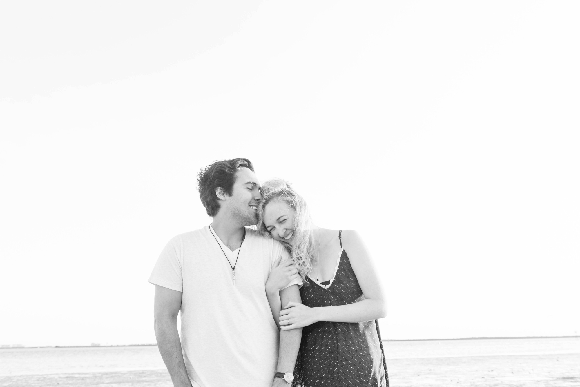 Playful Sunset Florida Couple Session , what to wear for engagement pictures, beach engagement pictures