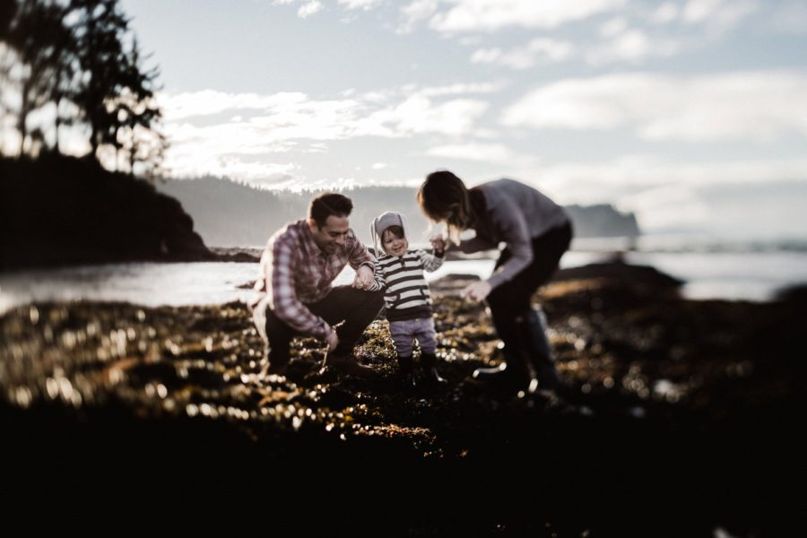 Laughing toddler with parents, Beachfront Family of 3
