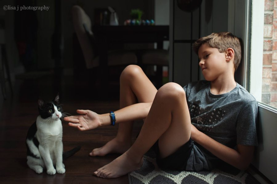 teen boy with pet cat