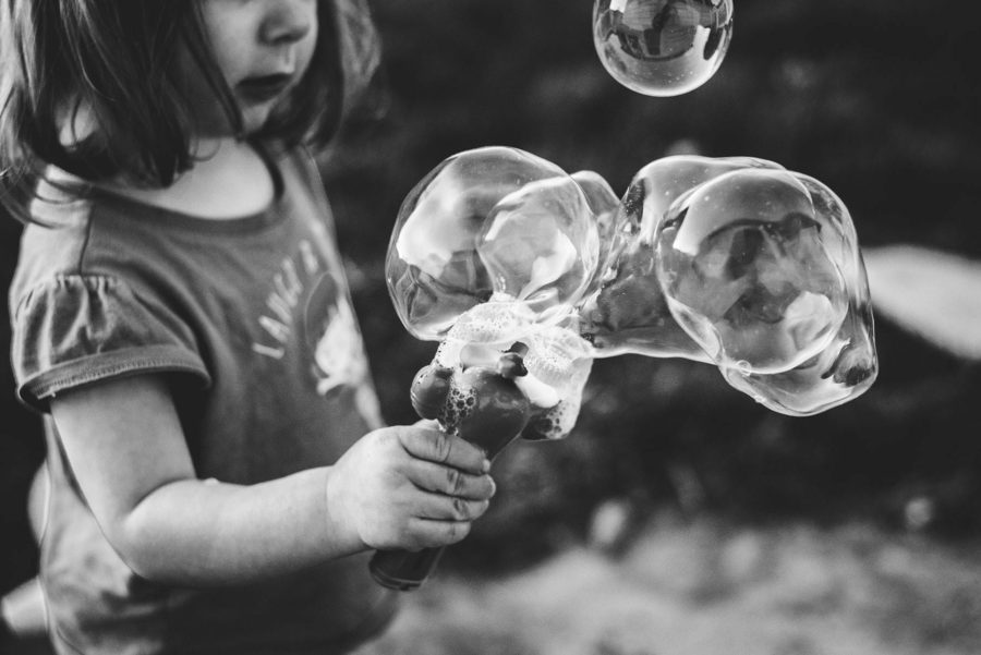 little girl playing with bubbles, daily fan favorite