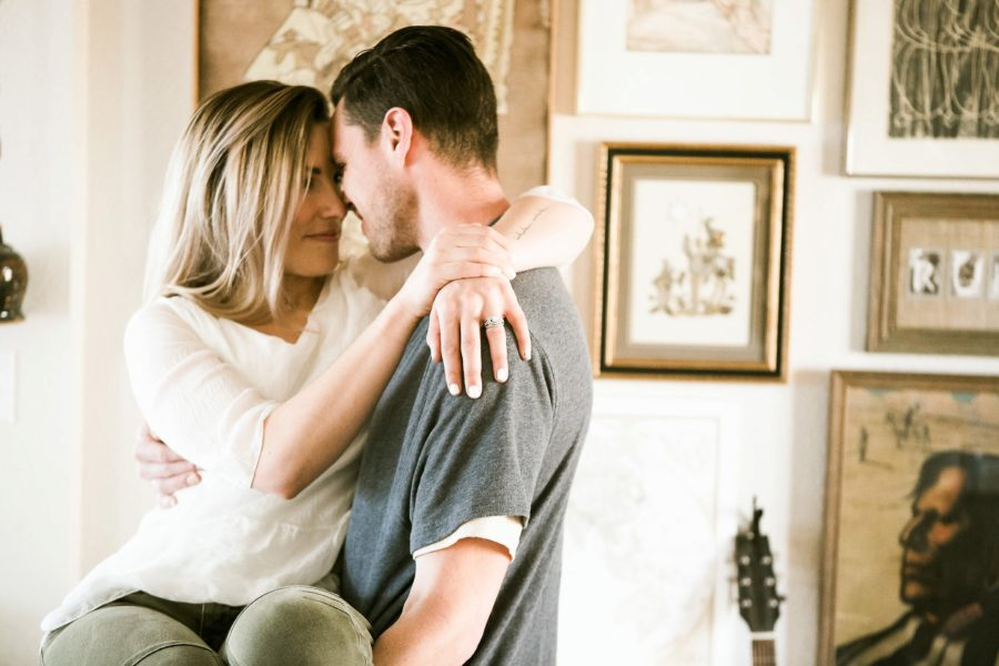 husband holding wife, Romantic in Home Anniversary Session