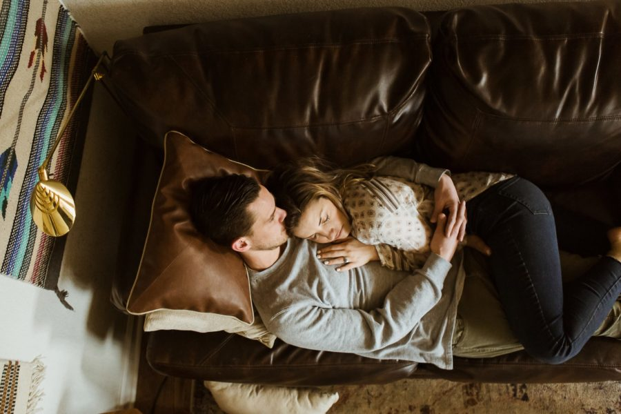 couple sleeping on couch together, Romantic in Home Anniversary Session