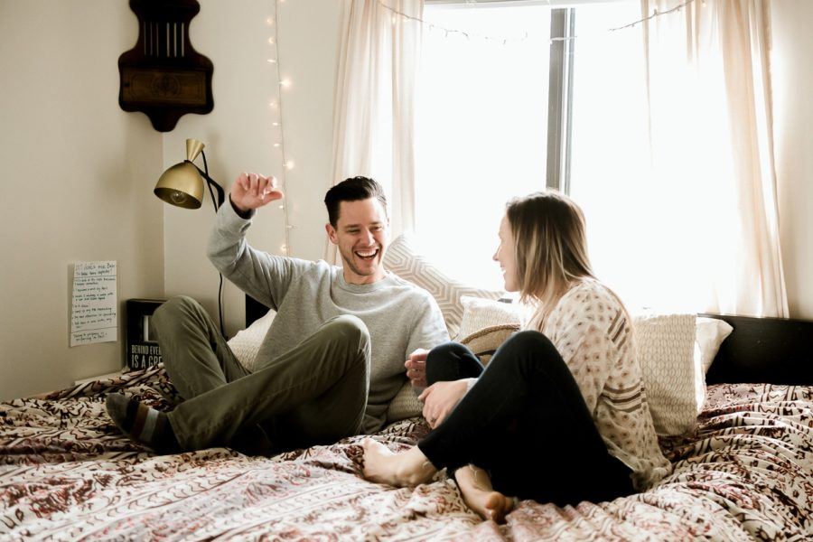 couple on bed laughing, Romantic in Home Anniversary Session
