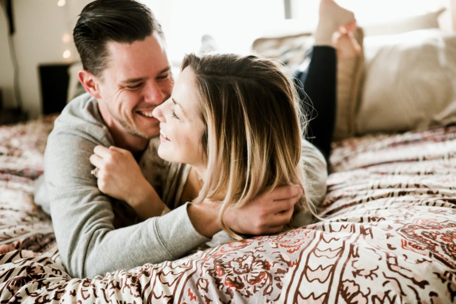 couple cuddling on bed, Romantic in Home Anniversary Session