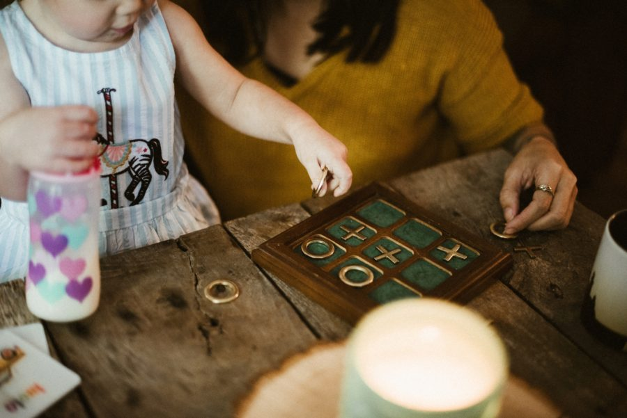 little girl playing game, In Home Boho Mother and Daughter Session