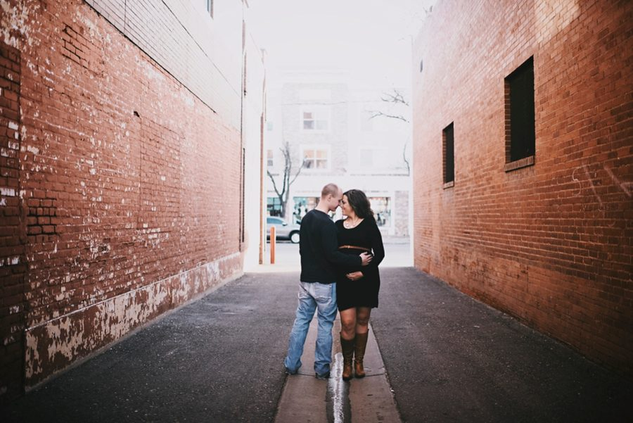 couple hugging for maternity, Downtown Alley Maternity Session in Colorado