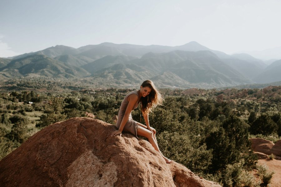girl sitting on mountain, Garden of the Gods Senior Pictures in Colorado