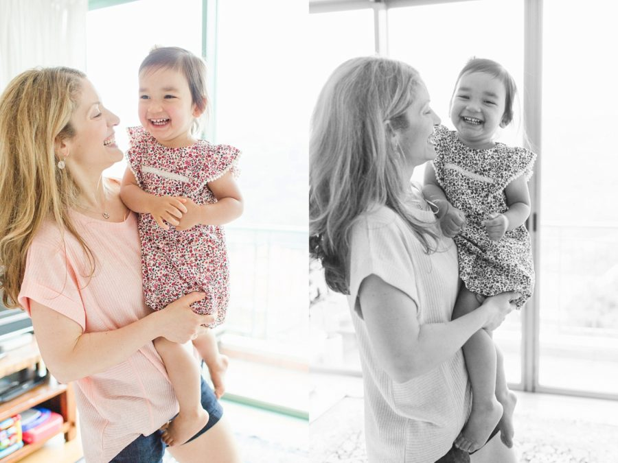 mom holding smiling daughter, Mommy & Me Cozy Home Session in Hong Kong