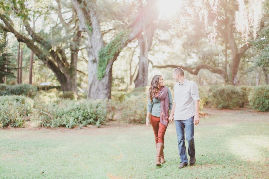 Happy couple walking in park, Spanish Moss Engagement Pictures in Florida