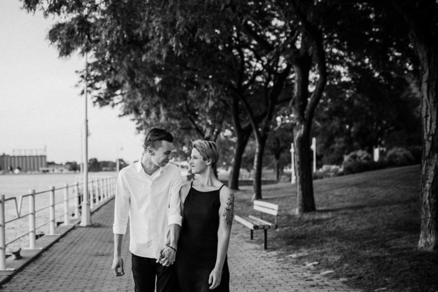 couple walking down boardwalk, Urban Couple Session in Downtown Ontario
