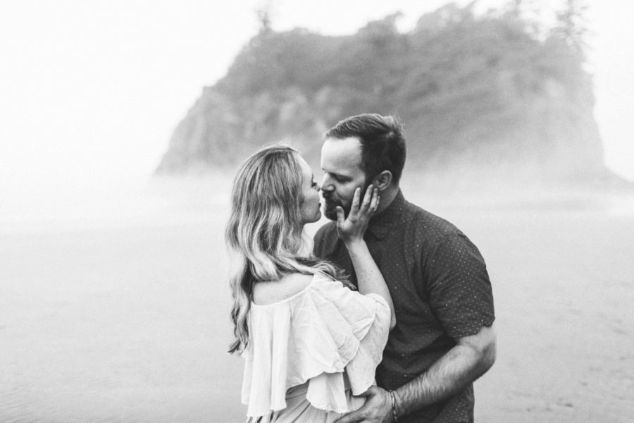 couple kissing on beach, Ruby Beach Intimate Maternity Pictures in Washington