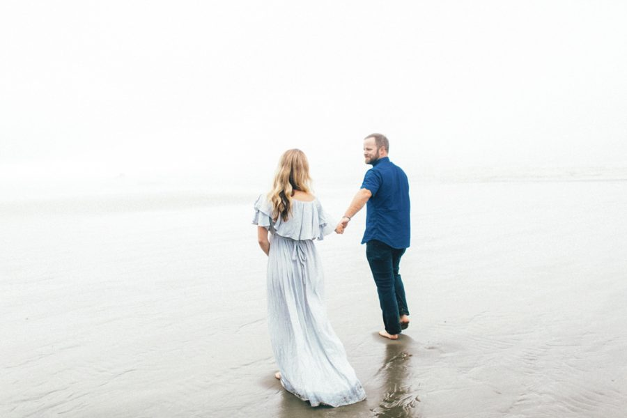 couple walking on beach, Ruby Beach Intimate Maternity Pictures in Washington