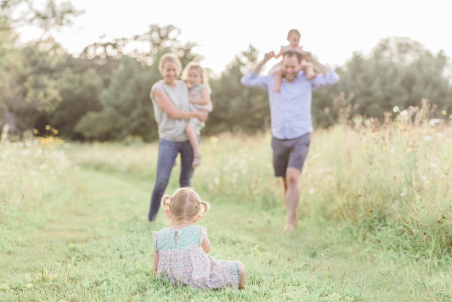 Parents with kids in field, Family session outside, Light-Drenched Family Portraits in Wisconsin