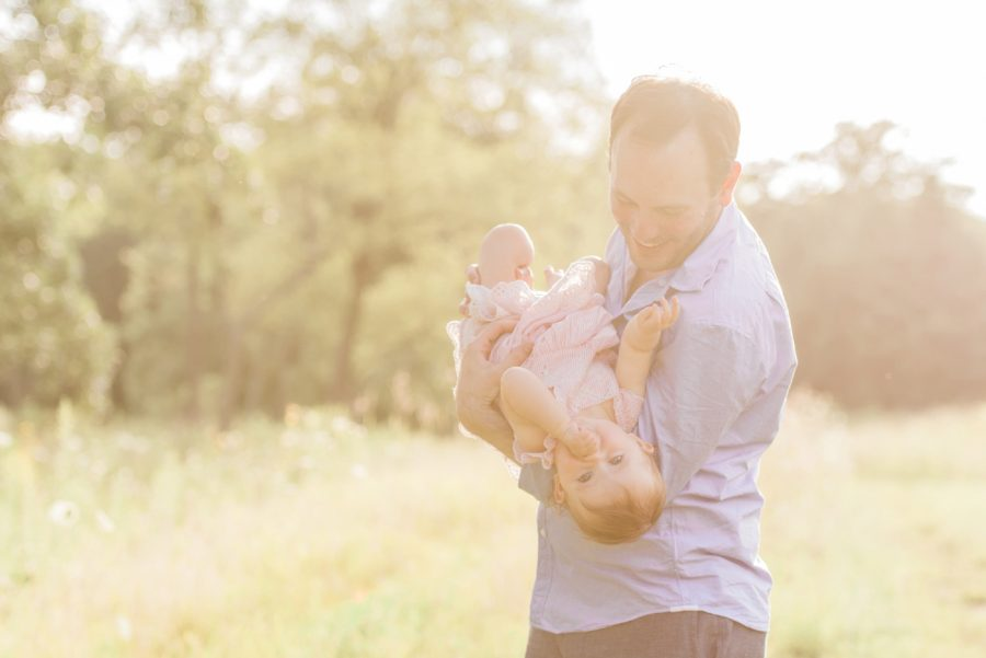 Father holding daughter, Sunlit portrait, Light-Drenched Family Portraits in Wisconsin