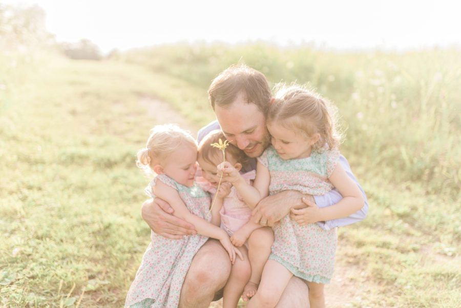 Daddy with daughters, Outdoor family session posing, Light-Drenched Family Portraits in Wisconsin