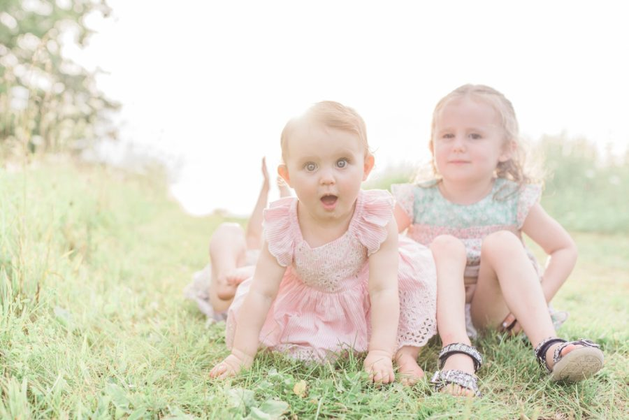 Baby in grass, Sisters, Light-Drenched Family Portraits in Wisconsin