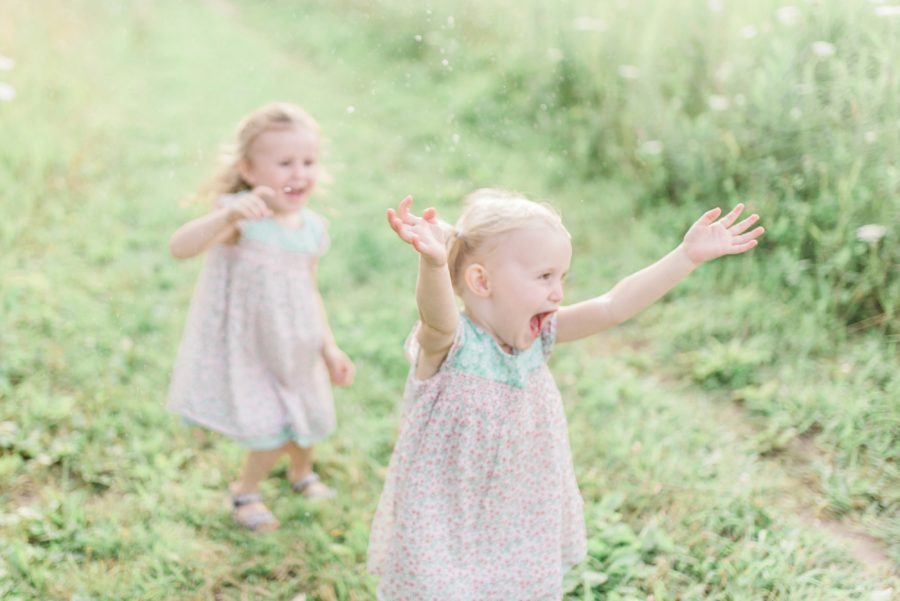 Kids popping bubbles, Outdoor session ideas, sisters, Light-Drenched Family Portraits in Wisconsin