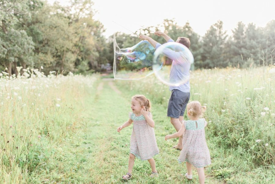 Girls with bubbles, huge bubbles, Light-Drenched Family Portraits in Wisconsin