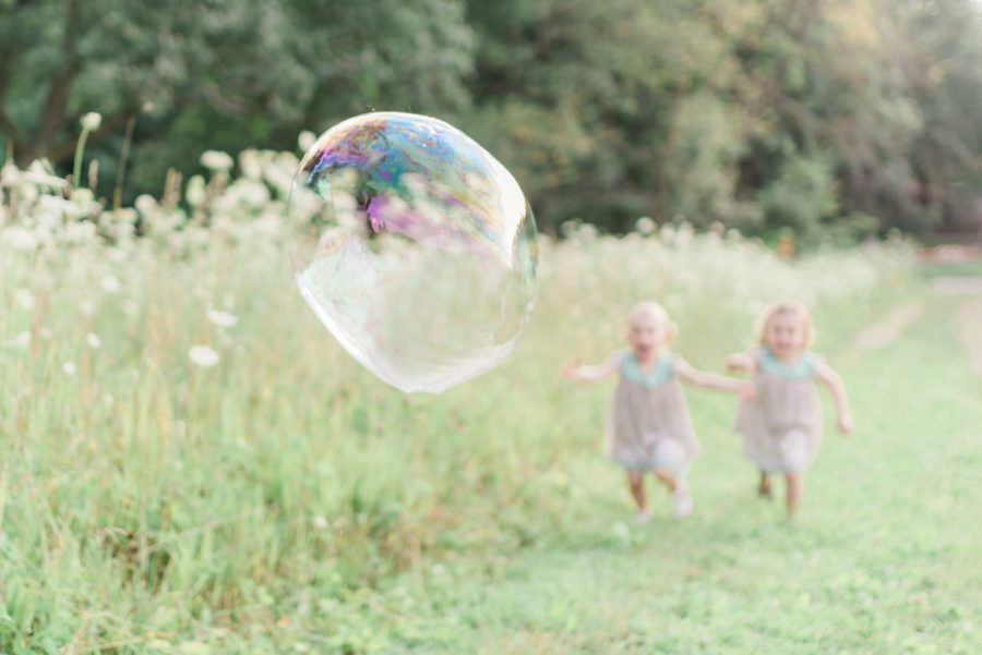 huge bubble, kids chasing bubble, Light-Drenched Family Portraits in Wisconsin