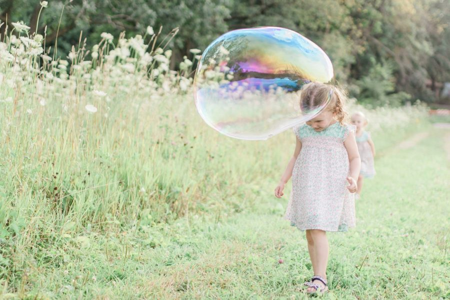 girl popping bubble, bubbles in family photos, Light-Drenched Family Portraits in Wisconsin