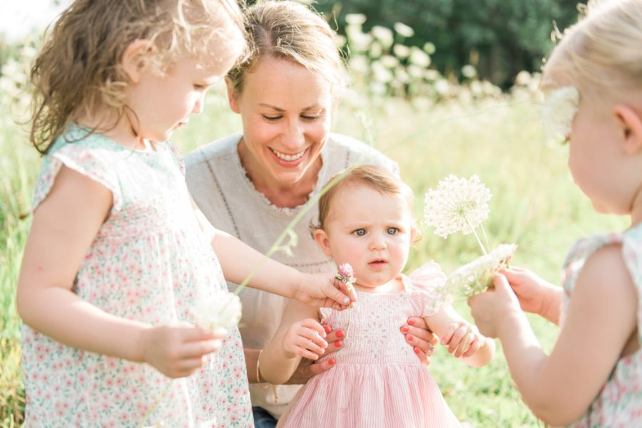 Girls picking flowers, Family session in field, Light-Drenched Family Portraits in Wisconsin