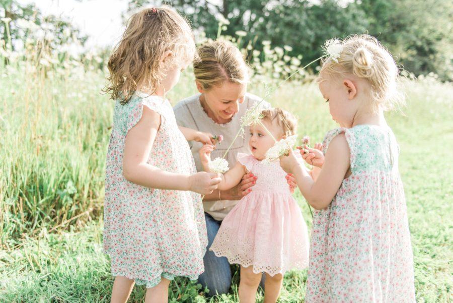 Sisters picking flowers, wildflowers, Photo of mom with kids, Light-Drenched Family Portraits in Wisconsin