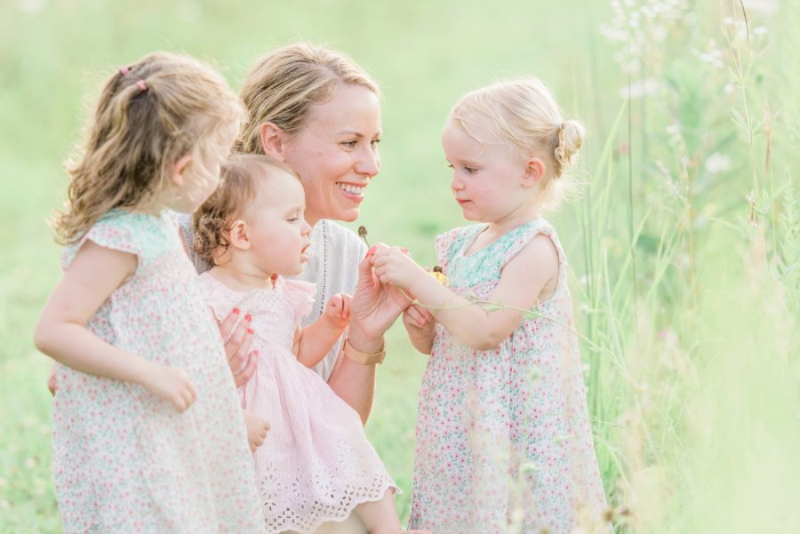 Mom picking flowers with daughters, woman smiling, sisters, Light-Drenched Family Portraits in Wisconsin