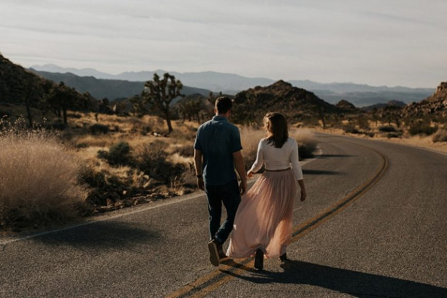 man and woman walking in road, Moody Couples Session at Joshua Tree