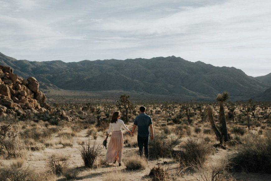 man and woman walking in desert, Moody Couples Session at Joshua Tree