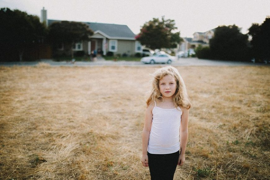 Girl standing in grass, simple portrait ideas, Wild and Free Childhood Portraits