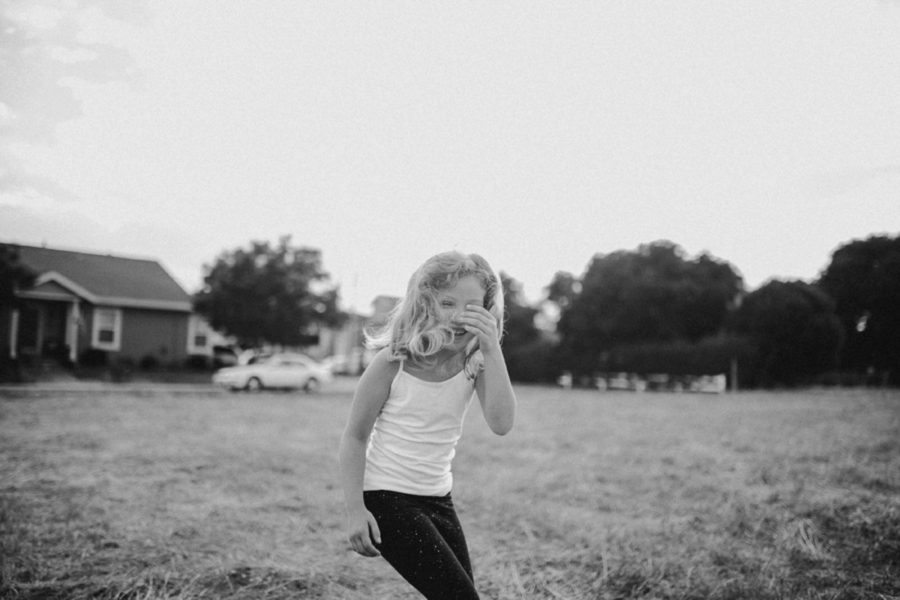 girl laughing, simple child pictures outside, Wild and Free Childhood Portraits