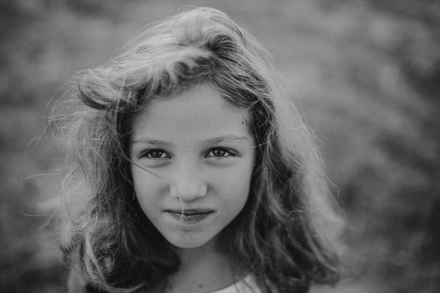 simple black and white portraits, girl with hair in face, Wild and Free Childhood Portraits