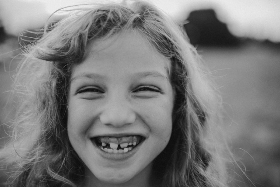 child with new adult teeth, big grin, Wild and Free Childhood Portraits