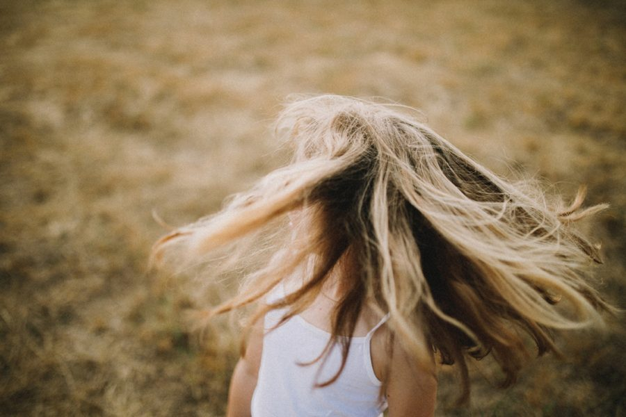 hair blowing in wind, girl spinning outside, Wild and Free Childhood Portraits