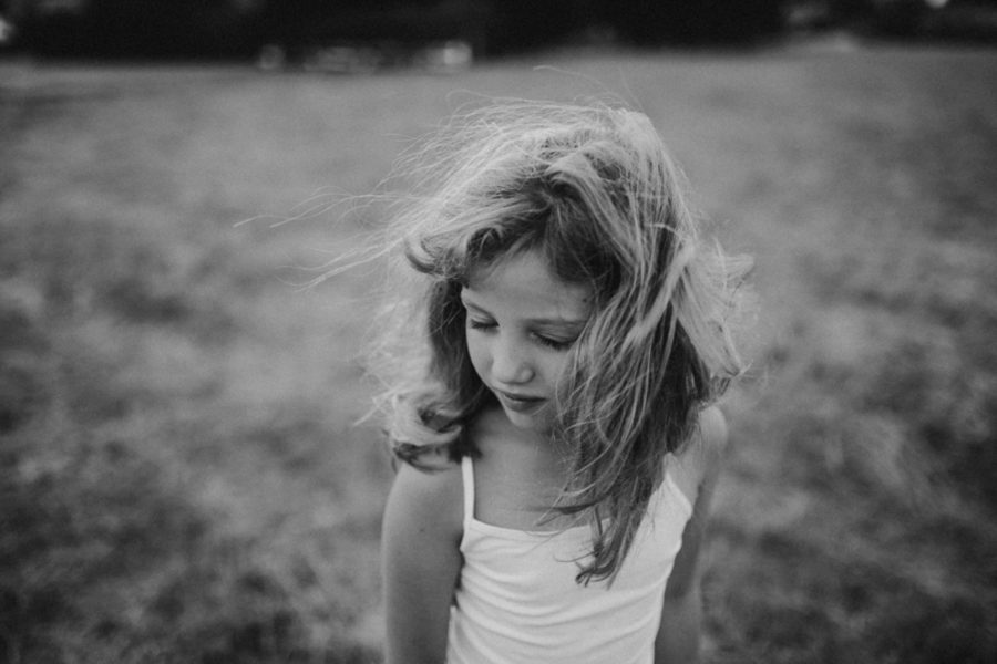 girl with hair blowing, portrait of young girl, Wild and Free Childhood Portraits