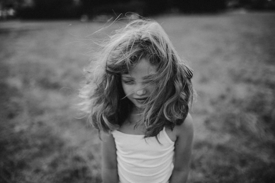 simple portrait of girl, hair blowing in face, Wild and Free Childhood Portraits