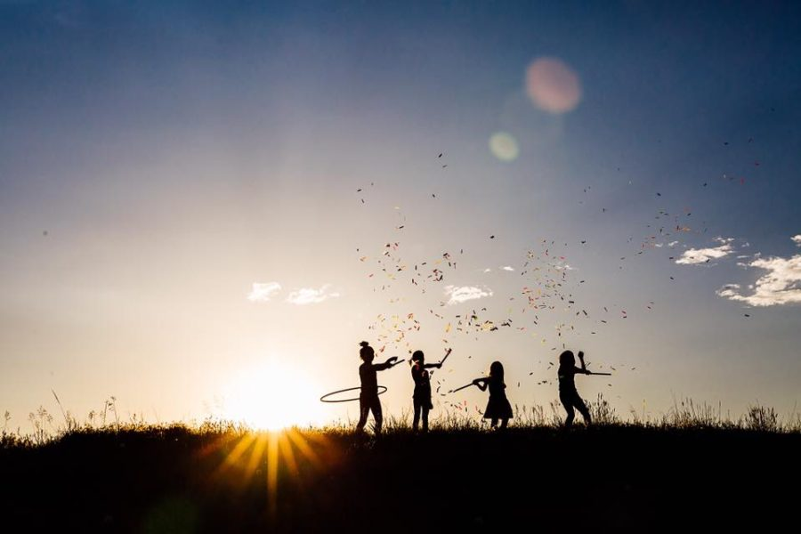 silhouette of children, big sky, child hula hooping