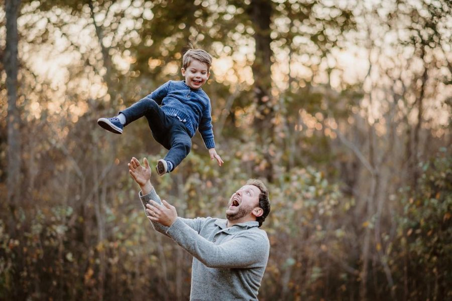 dad throwing son up in air