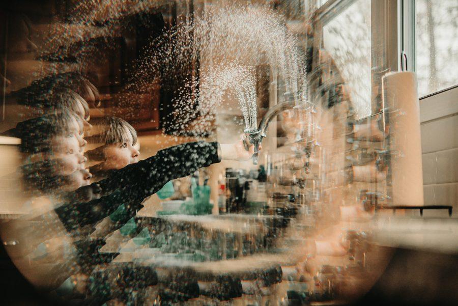 boy spraying water, kid playing at kitchen sink, fractal filters, Daily Fan Favorite on Beyond the Wanderlust