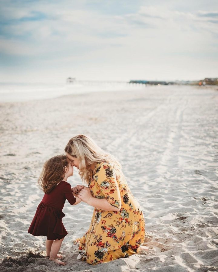 Mom and daughter on the beach, touching foreheads, Nicole Harnois Photography Daily Fan Favorite
