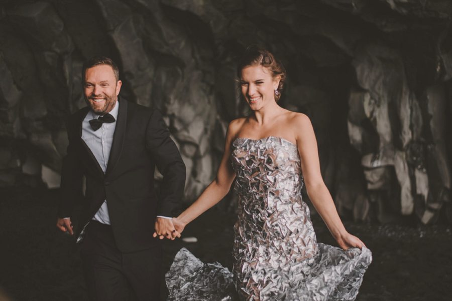 man and woman holding hands, couple walking together, Styled Elopement Pictures in Iceland