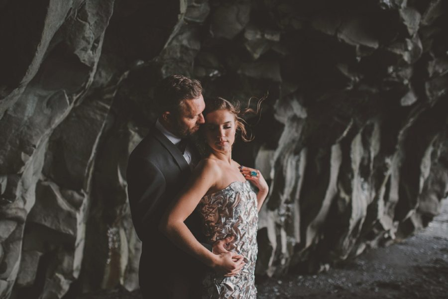 man and woman posing in cave, Styled Elopement Pictures in Iceland