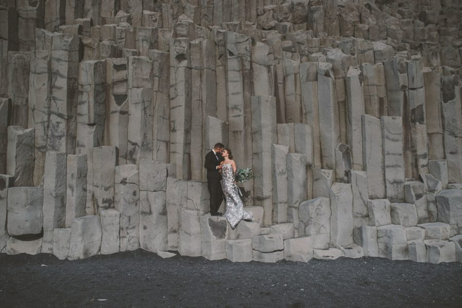 intimate wedding pictures on beach, couple standing on rocks, Styled Elopement Pictures in Iceland