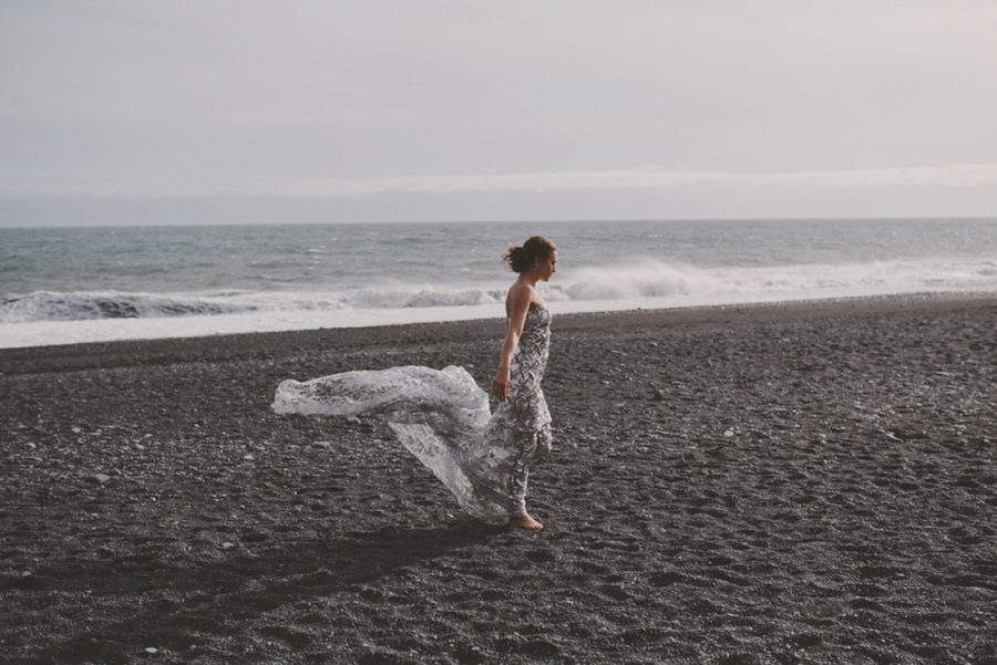 woman with dress on beach, billowing dress, Styled Elopement Pictures in Iceland