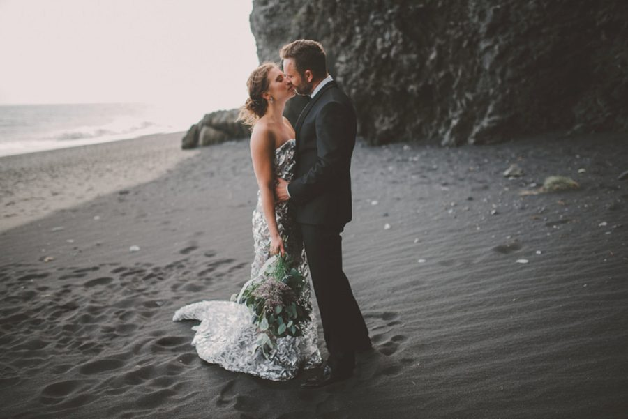 man and woman kissing on beach, styled wedding portraits on beach, Styled Elopement Pictures in Iceland