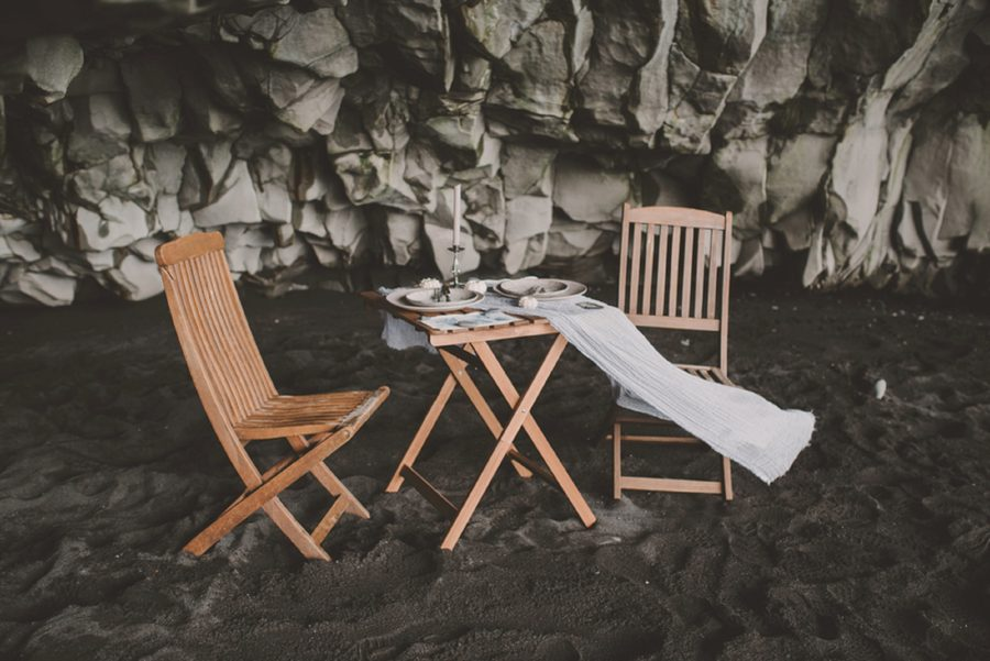 table and chairs on beach, styled table, tablecloth blowing, Styled Elopement Pictures in Iceland
