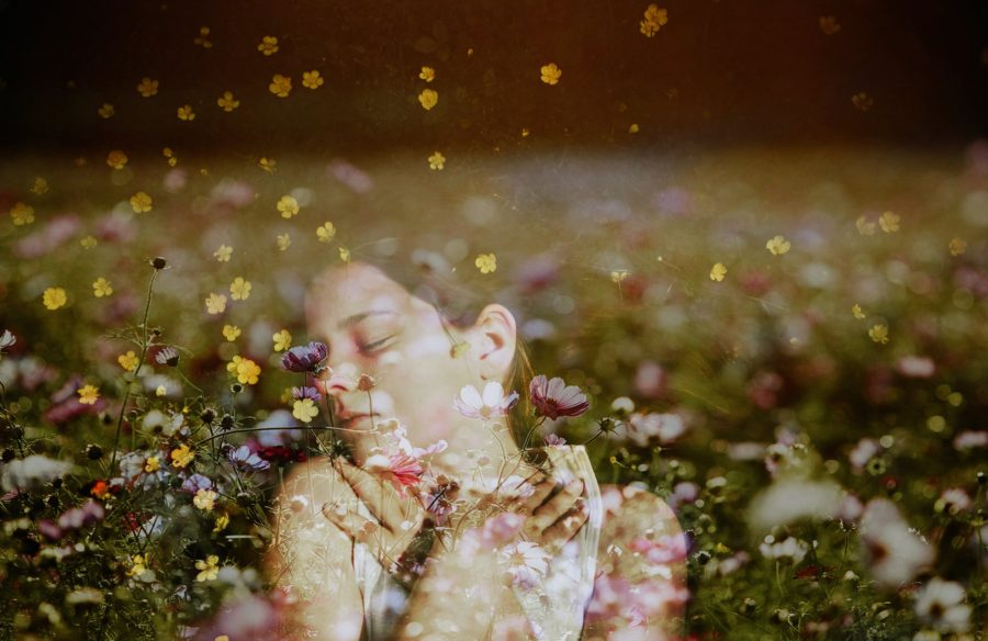 girl laying in flowers, double exposure with flowers