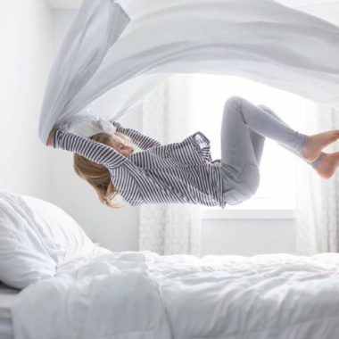child jumping on bed pulling sheet up over, unique jumping on the bed picture, Ashley Soeder Photography Daily Fan Favorite