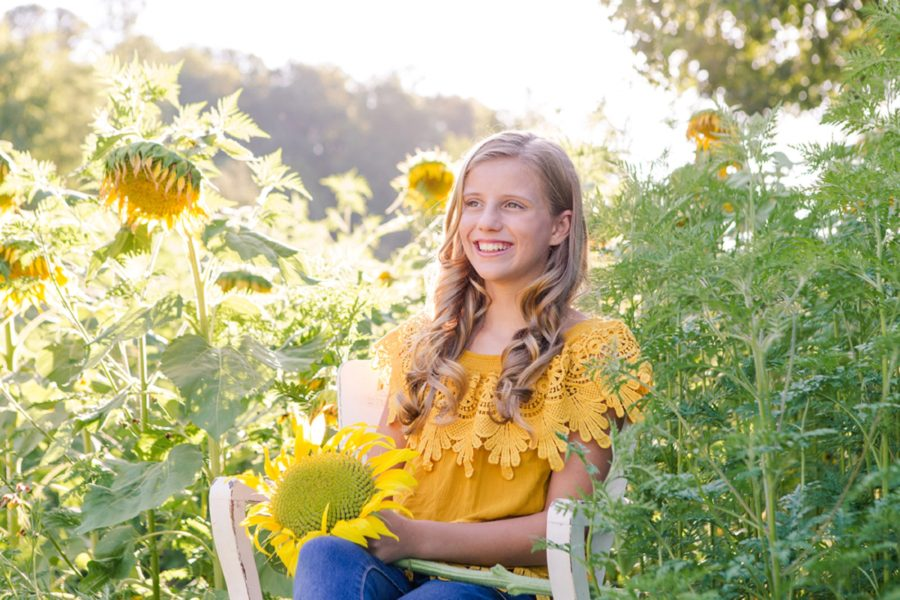 Teenager in sunflower field, Sweet 13 Photo Session in North Carolina
