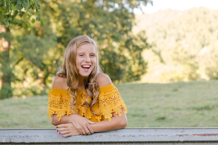 Girl laughing, girl leaning on metal fence, Sweet 13 Photo Session in North Carolina
